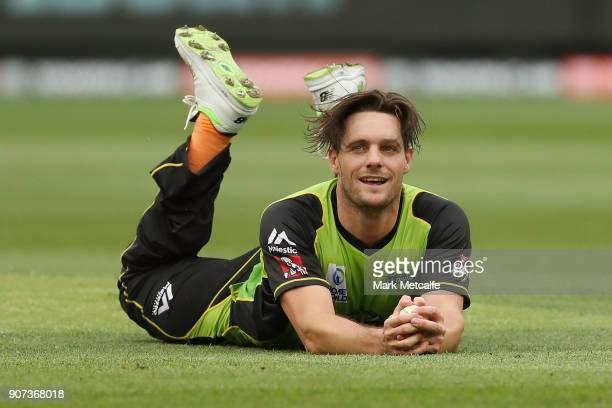 Mitchell McClenaghan of the Thunder celebrates taking the wicket of Peter Handscomb of the Stars during the Big Bash League match between the...