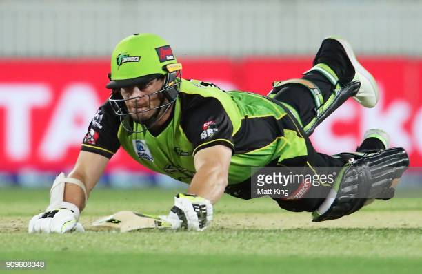 Mitchell McClenaghan of the Thunder slides in to avoid a runout during the Big Bash League match between the Sydney Thunder and the Melbourne...