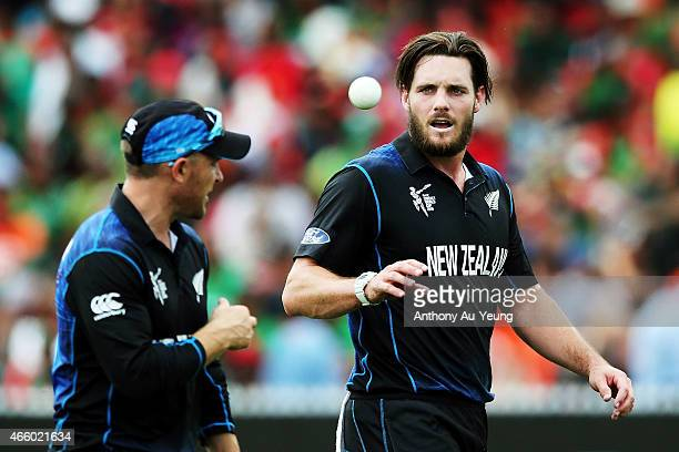 Mitchell McClenaghand of New Zealand catches the ball from teammate Brendon McCullum during the 2015 ICC Cricket World Cup match between Bangladesh...