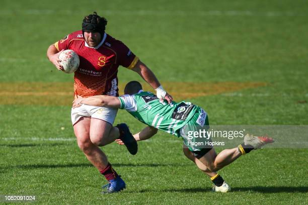 Mitchell Morgan of Southland is tackled by Kayne Hammington of Manawatu during the round nine Mitre 10 Cup match between Manawatu and Southland at...