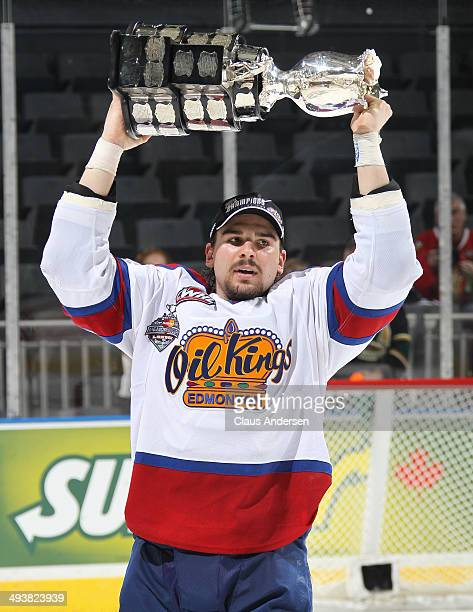Mitchell Moroz of the Edmonton Oil Kings hoists the MasterCard Memorial Cup after defeating the Guelph Storm in the final of the 2014 MasterCard...