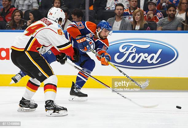 Mitchell Moroz of the Edmonton Oilers skates against Rasmus Andersson of the Calgary Flames on September 26 2016 at Rogers Place in Edmonton Alberta...