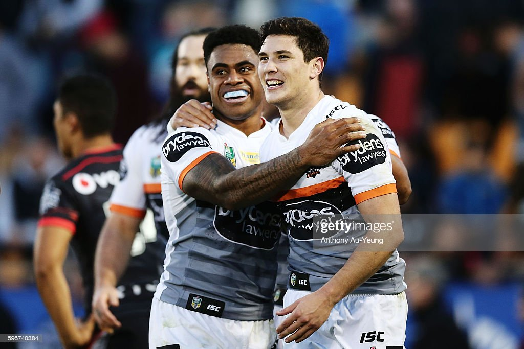 Mitchell Moses and Kevin Naiqama celebrate after a try during the round 25 NRL match between the New Zealand Warriors and the Wests Tigers at Mount Smart Stadium on August 28, 2016 in Auckland, New Zealand.