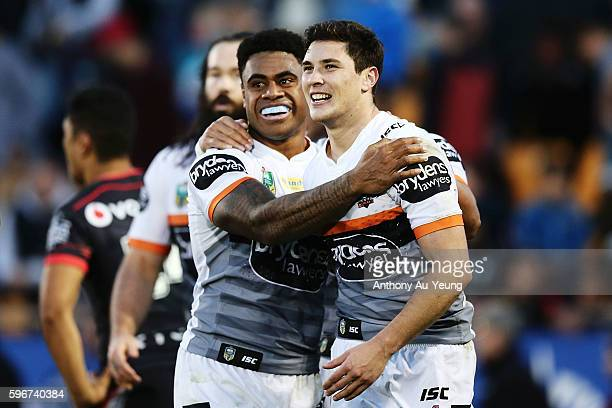 Mitchell Moses and Kevin Naiqama celebrate after a try during the round 25 NRL match between the New Zealand Warriors and the Wests Tigers at Mount...