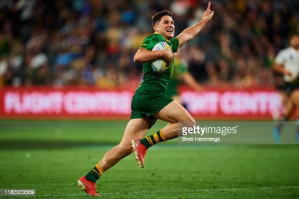 Mitchell Moses of Australia scores a try during the Final Rugby League World Cup 9s match between Australia and New Zealand at Bankwest Stadium on...