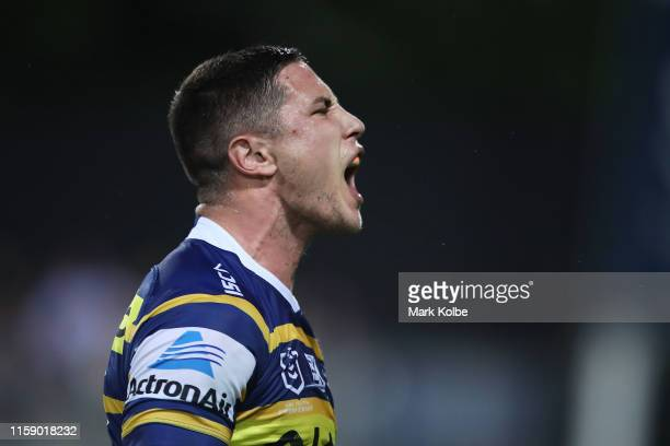 Mitchell Moses of the Eels celebrates scoring a try during the round 15 NRL match between the Parramatta Eels and the Canberra Raiders at TIO Stadium...