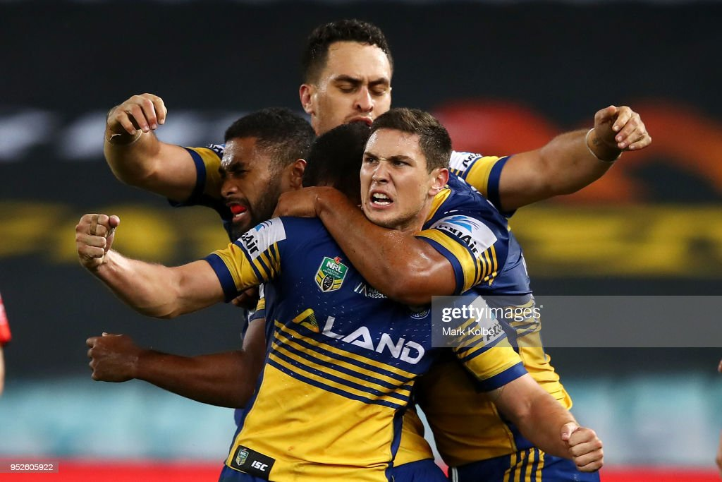 Mitchell Moses of the Eels celebrates victory with his team mates during the round Eight NRL match between the Parramatta Eels and the Wests Tigers at ANZ Stadium on April 29, 2018 in Sydney, Australia.