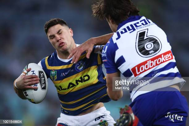 Mitchell Moses of the Eels is tackled during the round 19 NRL match between the Parramatta Eels and the Canterbury Bulldogs at ANZ Stadium on July 19...
