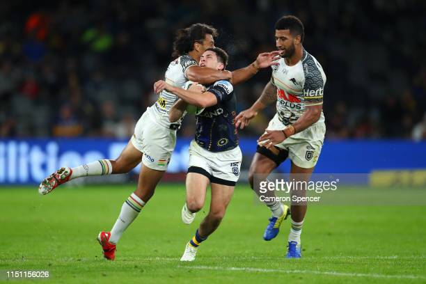 Mitchell Moses of the Eels is tackled high by Jarome Luai of the Panthers during the round 11 NRL match between the Parramatta Eels and the Penrith...
