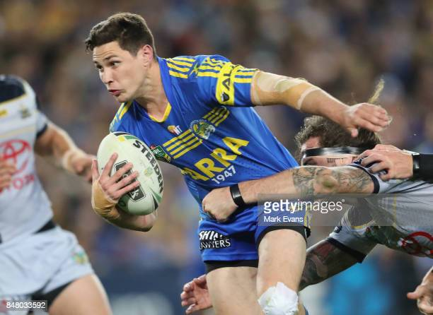 Mitchell Moses of the Eels istackledduring the NRL Semi Final match between the Parramatta Eels and the North Queensland Cowboys at ANZ Stadium on...
