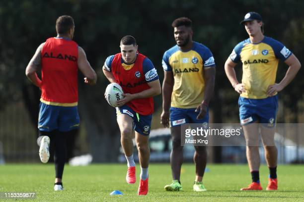 Mitchell Moses of the Eels runs with the ball during a Parramatta Eels NRL training session at Old Saleyards Reserve on June 03 2019 in Sydney...