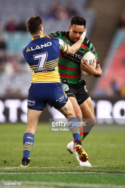 Mitchell Moses of the Eels tackles John Sutton of the Rabbitohs during the round 20 NRL match between the South Sydney Rabbitohs and the Parramatta...