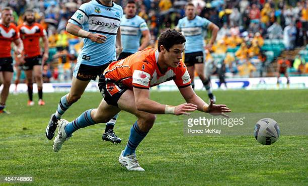 Mitchell Moses of the Tigers scores a try during the round 26 NRL match between the Wests Tigers and the Cronulla Sharks at Leichhardt Oval on...