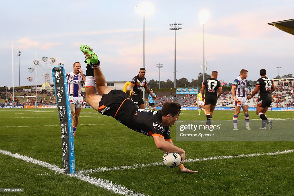 Mitchell Moses of the Tigers scores a try that was disallowed during the round 11 NRL match between the Wests Tigers and the Newcastle Knights at Campbelltown Sports Stadium on May 21, 2016 in Sydney, Australia.