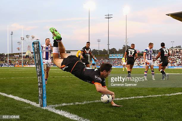 Mitchell Moses of the Tigers scores a try that was disallowed during the round 11 NRL match between the Wests Tigers and the Newcastle Knights at...