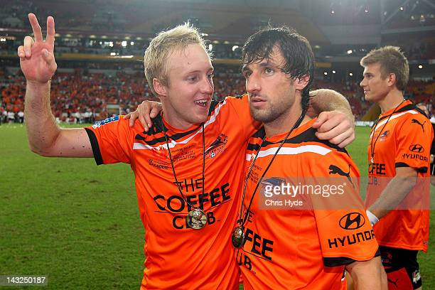 Mitchell Nichols and Thomas Broich of the Roar celebrate winning the 2012 ALeague Grand Final match between the Brisbane Roar and the Perth Glory at...