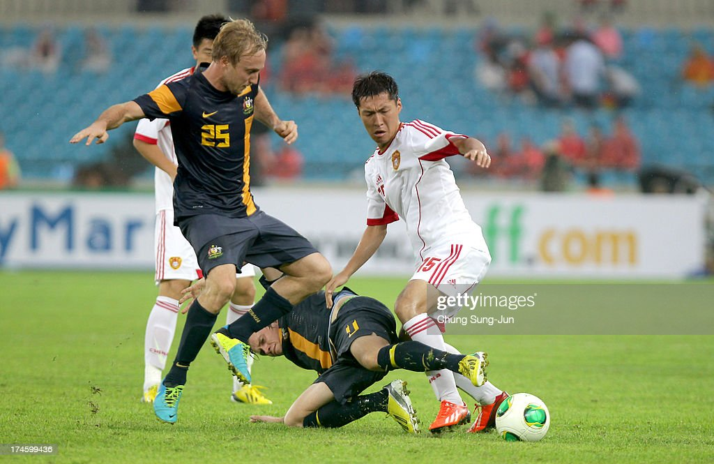 Mitchell Nichols of Australia competes for the ball with Wu Xi of China during the EAFF East Asian Cup match between Australia and China at Jamsil Stadium on July 28, 2013 in Seoul, South Korea.