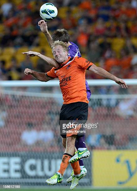 Mitchell Nichols of the Roar and Michael Thwaite of the Glory compete for the ball during the round 12 ALeague match between the Brisbane Roar and...