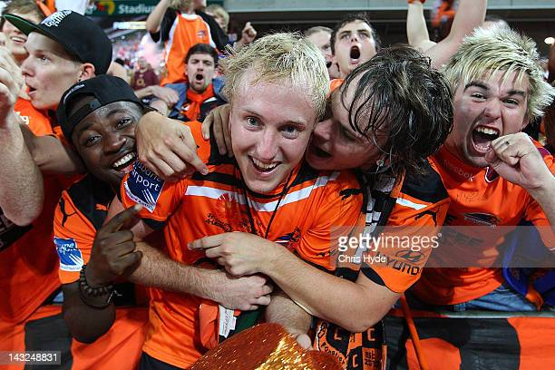Mitchell Nichols of the Roar celebrates with fans after winning the 2012 ALeague Grand Final match between the Brisbane Roar and the Perth Glory at...