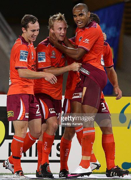 Mitchell Nichols of the Roar celebrates with team mates after scoring a goal during the round 11 ALeague match between the Brisbane Roar and the...