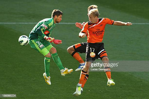 Mitchell Nichols of the Roar heads the ball during the round 11 ALeague match between the Melbourne Victory and the Brisbane Roar at AAMI Park on...