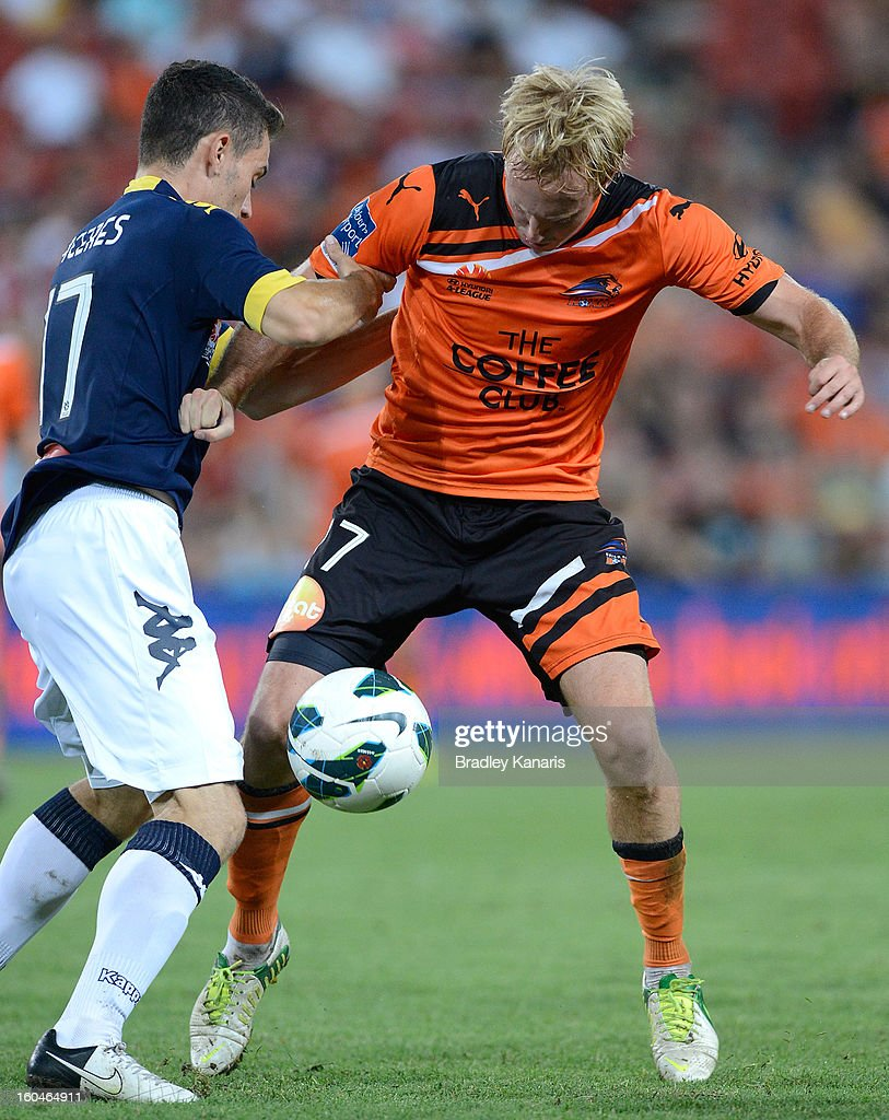 Mitchell Nichols of the Roar takes on the defence during the round 19 A-League match between the Brisbane Roar and the Central Coast Mariners at Suncorp Stadium on February 1, 2013 in Brisbane, Australia.