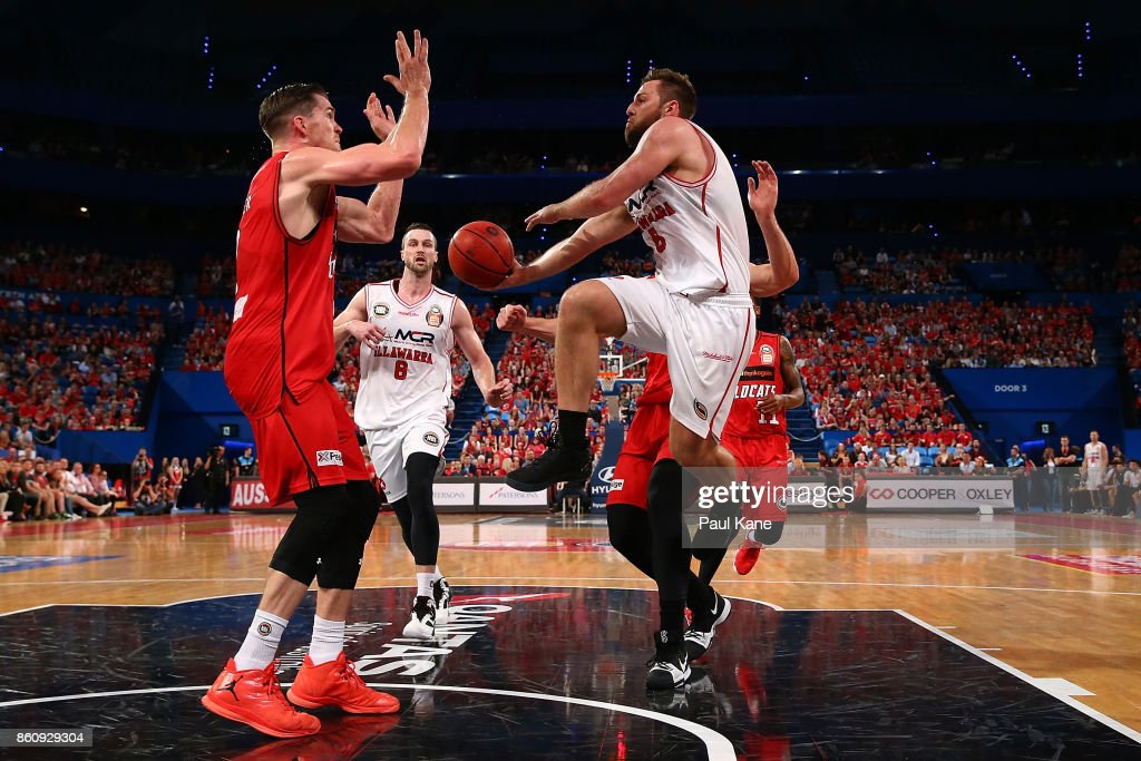 Mitchell Norton of the Hawks dishes the ball off during the round two NBL match between the Perth Wildcats and the Illawarra Hawks at Perth Arena on October 13, 2017 in Perth, Australia.