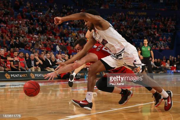 Mitchell Norton of the Wildcats and Justin Simon of the Hawks battle for the ball during game three of the NBL Semi-Final Series between the Perth...