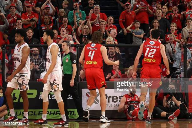 Mitchell Norton of the Wildcats celebrates a basket and drawing a foul during game three of the NBL Semi-Final Series between the Perth Wildcats and...