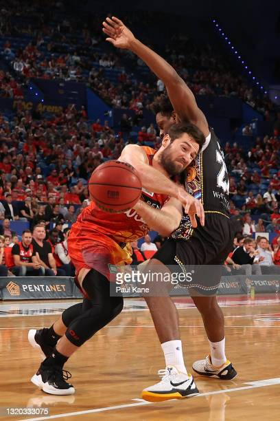 Mitchell Norton of the Wildcats clashes with Casper Ware of the Kings during the round 20 NBL match between the Perth Wildcats and the Sydney Kings...
