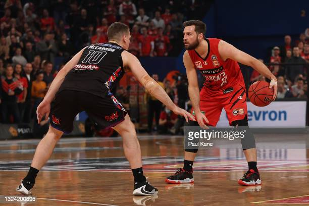 Mitchell Norton of the Wildcats controls the ball against Mitch McCarron of Melbourne United during game one of the NBL Grand Final Series between...