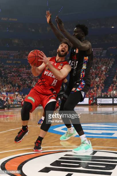 Mitchell Norton of the Wildcats goes to the basket against Jo Lual-Acuil of Melbourne United during game two of the NBL Grand Final Series between...
