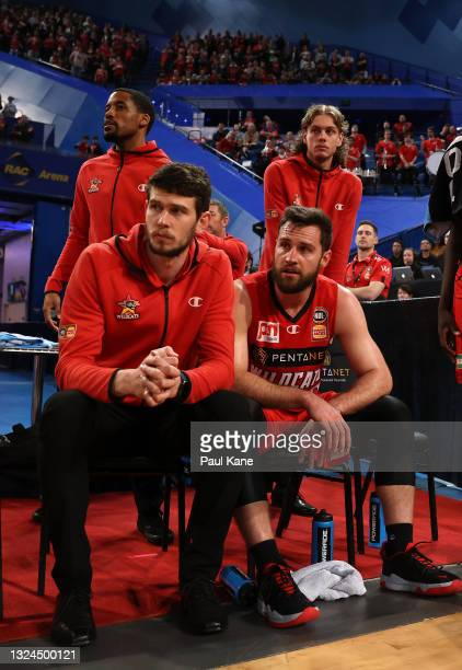 Mitchell Norton of the Wildcats looks on from the bench with Clint Steindl, Bryce Cotton and Luke Travers during game two of the NBL Grand Final...