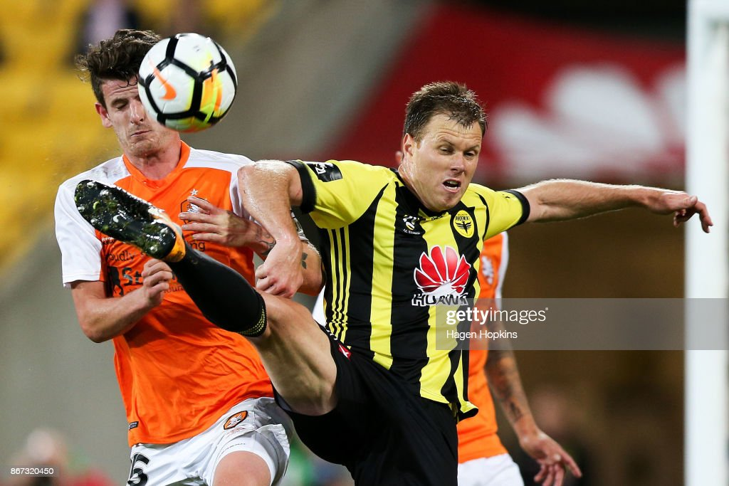 Mitchell Oxborrow of Brisbane and Daniel Mullen of the Phoenix compete for the ball during the round four A-League match between the Wellington Phoenix and the Brisbane Roar at Westpac Stadium on October 28, 2017 in Wellington, New Zealand.