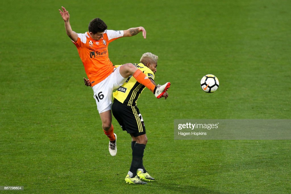 Mitchell Oxborrow of Brisbane challenges Roy Krishna of the Phoenix during the round four A-League match between the Wellington Phoenix and the Brisbane Roar at Westpac Stadium on October 28, 2017 in Wellington, New Zealand.