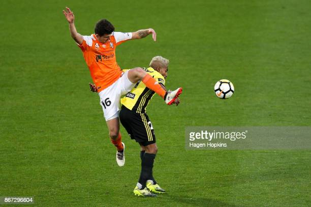 Mitchell Oxborrow of Brisbane challenges Roy Krishna of the Phoenix during the round four ALeague match between the Wellington Phoenix and the...
