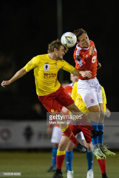 Mitchell Oxborrow of Broadmeadow and Daniel Subasic of Canberra FC contest possession during the FFA Cup round of 32 match between Canberra FC v...