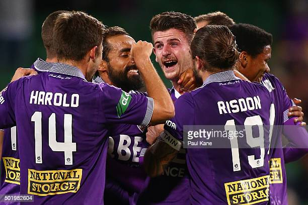 Mitchell Oxborrow of the Glory is congrtulated by team mates after scoring during the round 11 A-League match between the Perth Glory and the Western...