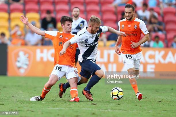 Mitchell Oxborrow of the Roar and Connor Pain of the Glory compete for the ball during the round five ALeague match between the Brisbane Roar and the...