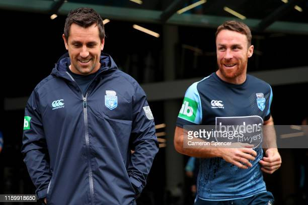 Mitchell Pearce and James Maloney of the Blues walk out onto the field to train during a New South Wales Blues State of Origin training session at...