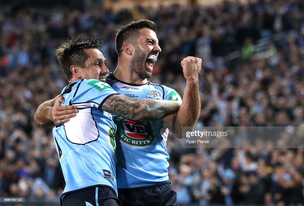 Mitchell Pearce and James Tedesco of the Blues celebrate after Pearce scored a try during game two of the State Of Origin series between the New South Wales Blues and the Queensland Maroons at ANZ Stadium on June 21, 2017 in Sydney, Australia.