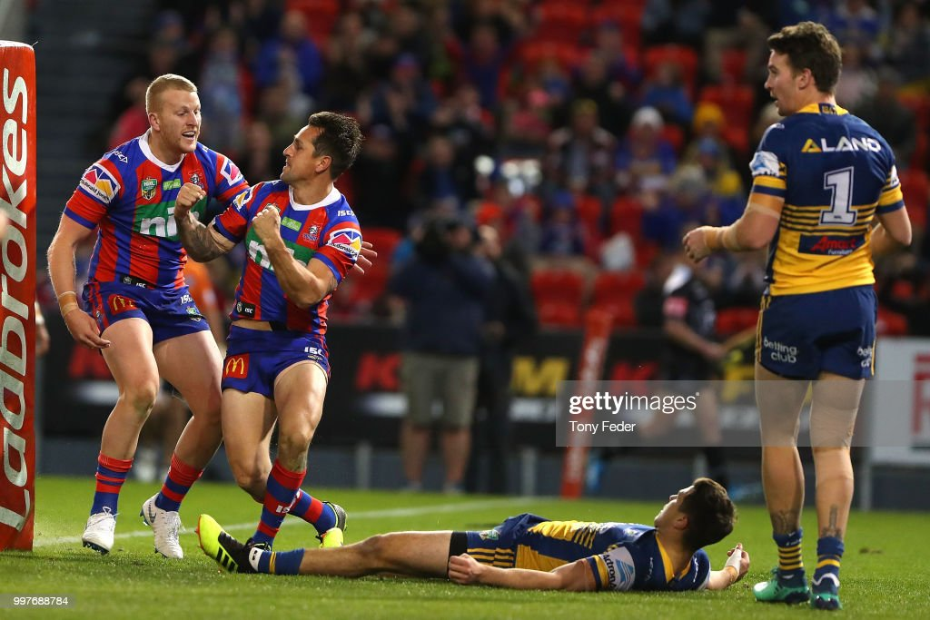 Mitchell Pearce and Mitch Barnett of the Knights celebrate a try during the round 18 NRL match between the Newcastle Knights and the Parramatta Eels at McDonald Jones Stadium on July 13, 2018 in Newcastle, Australia.