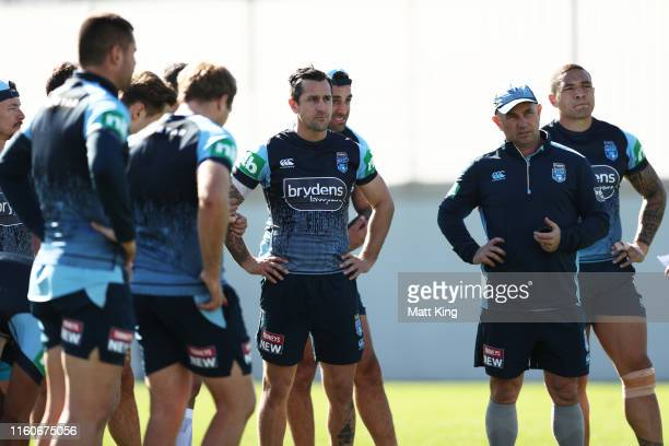 Mitchell Pearce and team mates listen to coaches during a New South Wales Blues State of Origin training session at the NSWRL Centre of Excellence on...