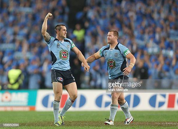 Mitchell Pearce and Trent Merrin of the Blues celebrate victory during game one of the ARL State of Origin series between the New South Wales Blues...
