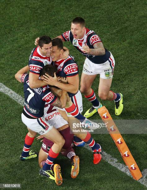 Mitchell Pearce Anthony Minichiello Sonny Bill Williams and Shaun KennyDowall of the Roosters celebrate at fulltime after winning the 2013 NRL Grand...