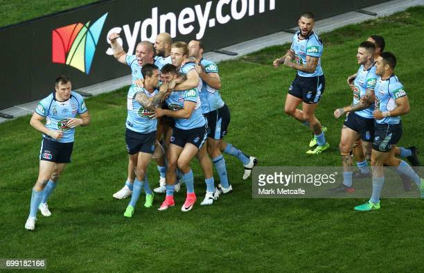 Mitchell Pearce of the Blues celebrates scoring a try with team mates during game two of the State Of Origin series between the New South Wales Blues...