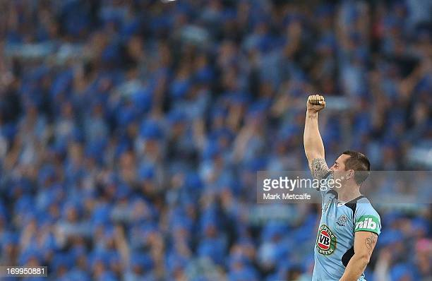 Mitchell Pearce of the Blues celebrates victory during game one of the ARL State of Origin series between the New South Wales Blues and the...