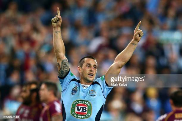 Mitchell Pearce of the Blues celebrates winning game one of the ARL State of Origin series between the New South Wales Blues and the Queensland...