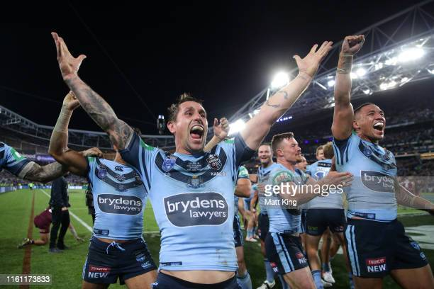 Mitchell Pearce of the Blues celebrates with team mates after winning game three of the 2019 State of Origin series between the New South Wales Blues...