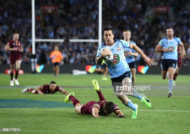 Mitchell Pearce of the Blues runs in to score a try during game two of the State Of Origin series between the New South Wales Blues and the...